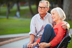 Mature Romantic Couple Sitting On Park Bench Together Royalty Free Stock Photos