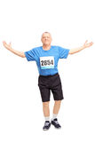 Mature runner celebrating his victory Stock Photos