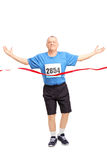 Mature runner celebrating his victory Stock Photography