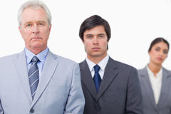 Mature salesman standing with employees Stock Photography