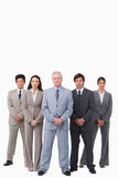 Mature salesman standing together with his team Royalty Free Stock Image