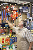 Mature salesperson working in hardware store Stock Photography