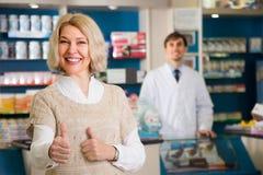 Mature satisfied woman buys drugs stock photos