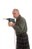 Mature scotsman using a power drill Stock Images