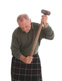 Mature Scotsman working with a large hammer Royalty Free Stock Photography