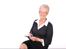 Mature Secretary taking notes Stock Photo