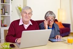 Mature senior couple smiling with technology Royalty Free Stock Image