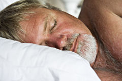 Mature senior man sleeping peacefully Royalty Free Stock Photo