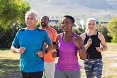 Mature and senior people jogging at park royalty free stock photo