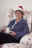Mature Senior Woman Christmas Entertain Santa Hat Stock Photography