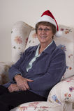 Mature Senior Woman Christmas Holiday Santa Hat Royalty Free Stock Photo