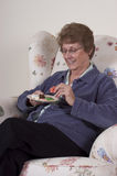 Mature Senior Woman Eating Holidays Cookies, Snack Stock Photo