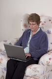 Mature Senior Woman Laptop Computer, Serious Look Stock Photography
