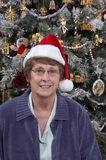 Mature Senior Woman Santa Claus Hat Christmas Tree Royalty Free Stock Photography