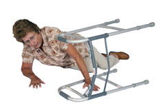 Mature Senior Woman, Walker, Accident Fell Down. Mature senior woman has an accident in the home, slips and falls down with her walker. Scene represents mobility Stock Images