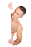 Mature shirtless man holding empty banner Royalty Free Stock Image