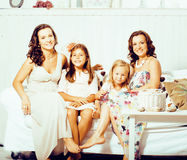 Mature sisters twins at home with little cute daughter, happy real family smiling together, lifestyle people concept Stock Photos