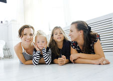 Mature sisters twins at home with little daughter Royalty Free Stock Images