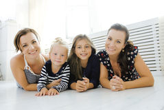 Mature sisters twins at home with little daughter Stock Images