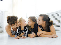 Mature sisters twins at home with little daughter Royalty Free Stock Photography