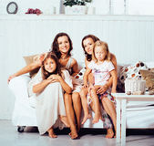Mature sisters twins at home with little daughter, happy family in interior, lifestyle people concept Royalty Free Stock Images
