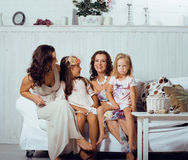 Mature sisters twins at home with little daughter, happy family Stock Image