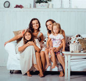 Mature sisters twins at home with little daughter, happy family Royalty Free Stock Photos