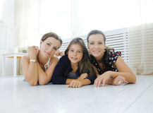 Mature sisters twins at home with little daughter, happy family smiling close up, lifestyle modern real people concept Royalty Free Stock Photography
