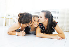 Mature sisters twins at home with little daughter, happy family Royalty Free Stock Photo