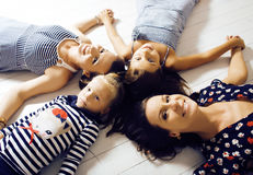 Mature sisters twins at home with little daughter, happy family Stock Images