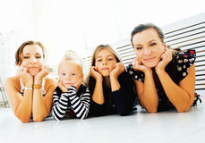 Mature sisters twins at home with little daughter, happy family Royalty Free Stock Images