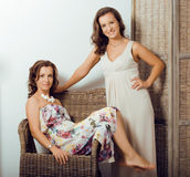 Mature sisters twins at home Royalty Free Stock Photography