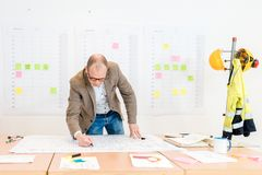 Contractor Making Architectural Plan In Conference Room stock images