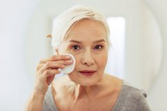 Face of a nice aged woman with mimic wrinkles. Mature skin. Face of a nice aged woman with small mimic wrinkles royalty free stock images