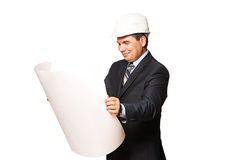 Mature smiling architect holding a building plan,. Male smiling architect holding a building plan royalty free stock photo