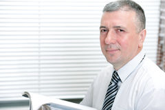 Mature smiling business man Stock Image