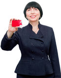 Mature smiling business woman. Confident mature smiling business woman holding a credit card Royalty Free Stock Images