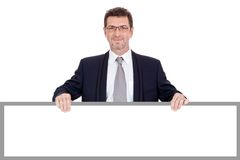Mature smiling businessman holding billboard copyspace isolated Royalty Free Stock Photos