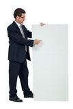 Mature smiling businessman holding billboard copyspace isolated Stock Image