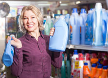 Mature smiling female with selecting fabric conditioner Stock Photography