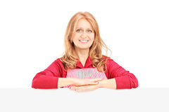 Mature smiling female wearing an apron and posing on a blank pan Stock Images