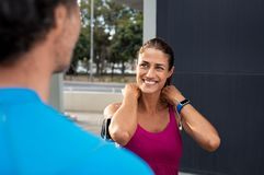 Mature smiling fitness woman with man royalty free stock image