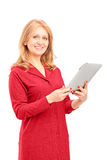 Mature smiling woman holding a tablet and looking at camera Royalty Free Stock Image