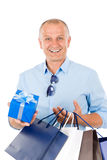 Mature smilling man hold shopping bags Royalty Free Stock Image