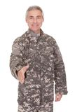 Mature Soldier Extending Hand To Shake Stock Photography