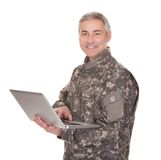 Mature Soldier Holding Laptop. Isolated On White Background stock images