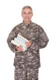 Mature Soldier Holding Stack Of Books Stock Photos