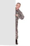 Mature Soldier Showing On Blank Placard Royalty Free Stock Photos