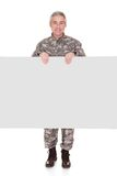 Mature Soldier Showing On Blank Placard Royalty Free Stock Images