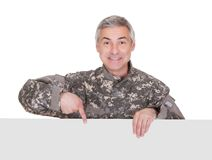 Mature Soldier Showing On Blank Placard Stock Images